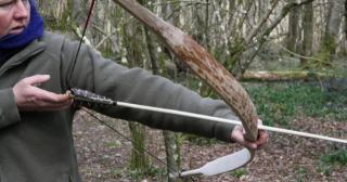 Testing a finished bow and arrow