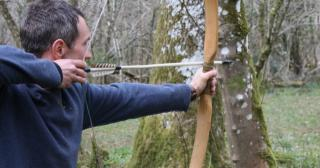 Shooting a stone age bow