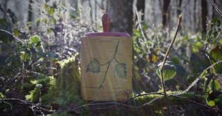 Birch bark container with leaf design