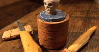 Birch bark tub with carved wooden lid