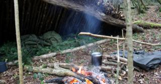 Lean-to shelter and spruce bough bed