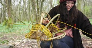 Hand weaving a foraging basket