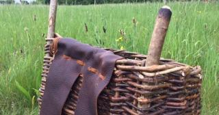 Woven willow pack basket with leather straps
