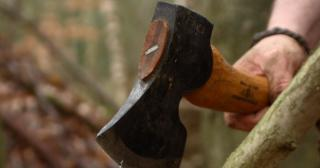 Using an axe to carve with