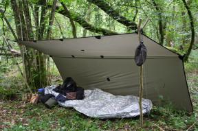 The same rig 3.5 tarp set up as a good sized, one person survival shelter